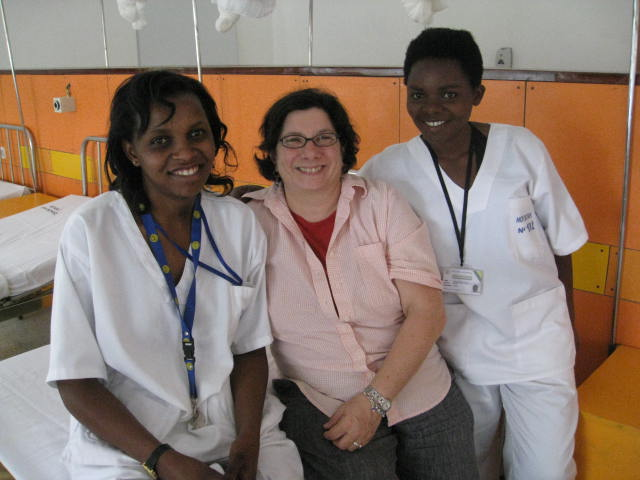Barbara Virchick, center, with two Rwandan nurses.