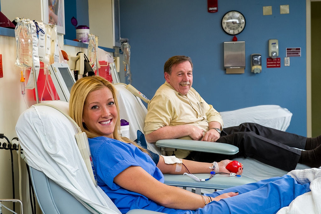 Bob Hurkett at his 300th platelet donation, with his daughter, Molly, at her sixth.