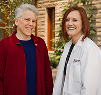 Elizabeth Cahn (left) was in a clinical trial for breast cancer, and Karen Schulte, NP, was her research nurse.