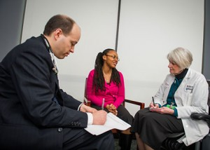 Douglas Branoff, MD and Maureen Lynch, RN, NP discuss palliative care with a patient.