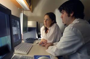 Technicians Tim Belisle and Tricia Locascio of Nuclear Medicine in the PET/CT control room.