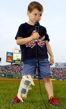 Four-year-old Jordan Leandre sings the National Anthem before the start of a Red Sox game in 2004.