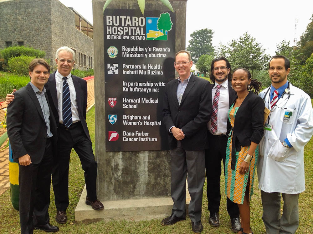 Lawrence Shulman, MD, (second from left) with NASCAR's Jeff Gordon, Paul Farmer, MD, PhD, and others at the entrance to Butaro Hospital in Rwanda.