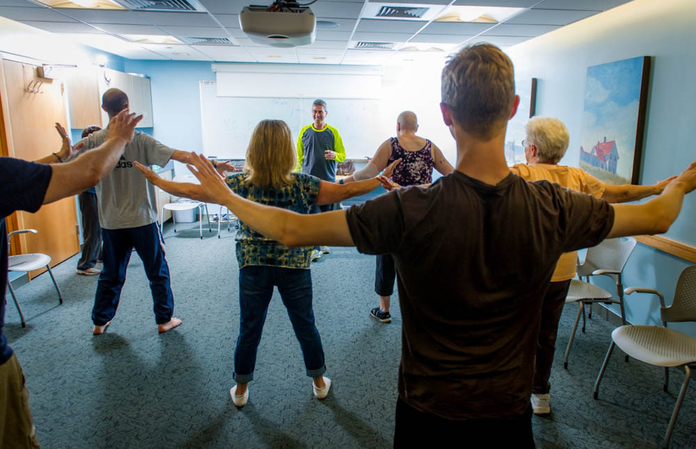 Zakim Center qigong and tai chi master, Rami Romes, teaches qigong to Dana-Farber patients.