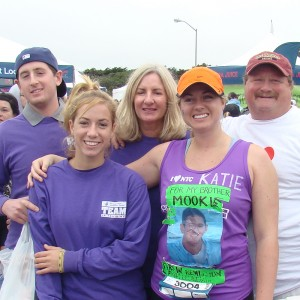 The Matarazzo family gathers at the 2008 San Francisco Marathon. Front row, left to right: daughters Meg, Katie; Back row, left to right: son Michael, mother Joanne, father Stephen. Katie ran the race in honor of her brother Michael (whose photo adorns her shirt) just after he finished his ALL treatment at Dana-Farber.