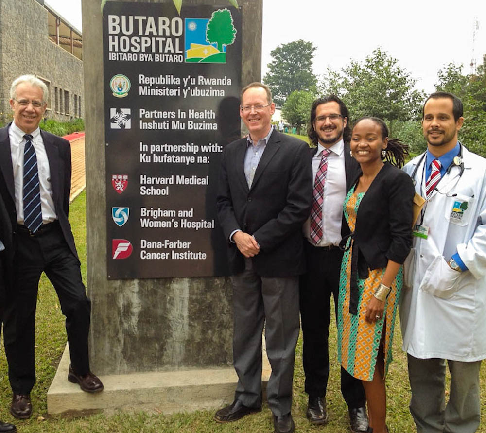 Lawrence Shulman, MD, (left) with Paul Farmer, MD, PhD, and others at the entrance to Butaro Hospital in Rwanda.