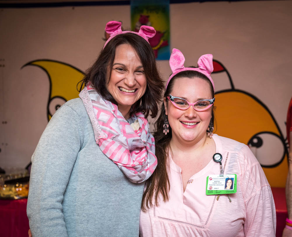 Lisa Scherber and Martha Young from the Jimmy Fund Clinic dress in pink for the 2015 Pig Day.