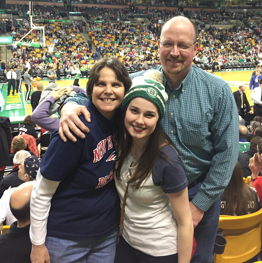 Sarah and her parents at a Boston Celtics game