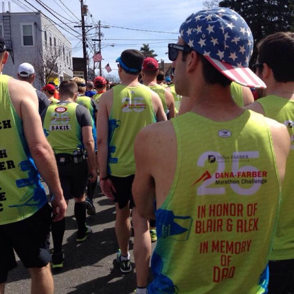 The back of Eric's singlet: Running in honor of Blair & Alex and in memory of Dad.
