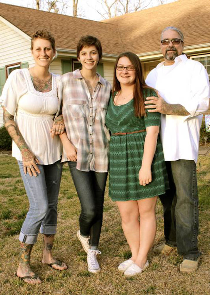 Beth with her two daughters and her husband.
