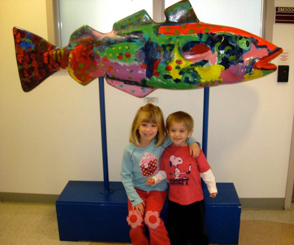 The fun activities provided through the Sibling Program helped Stella (left) look forward to hospital visits while her younger brother, Christopher (right), was in treatment.