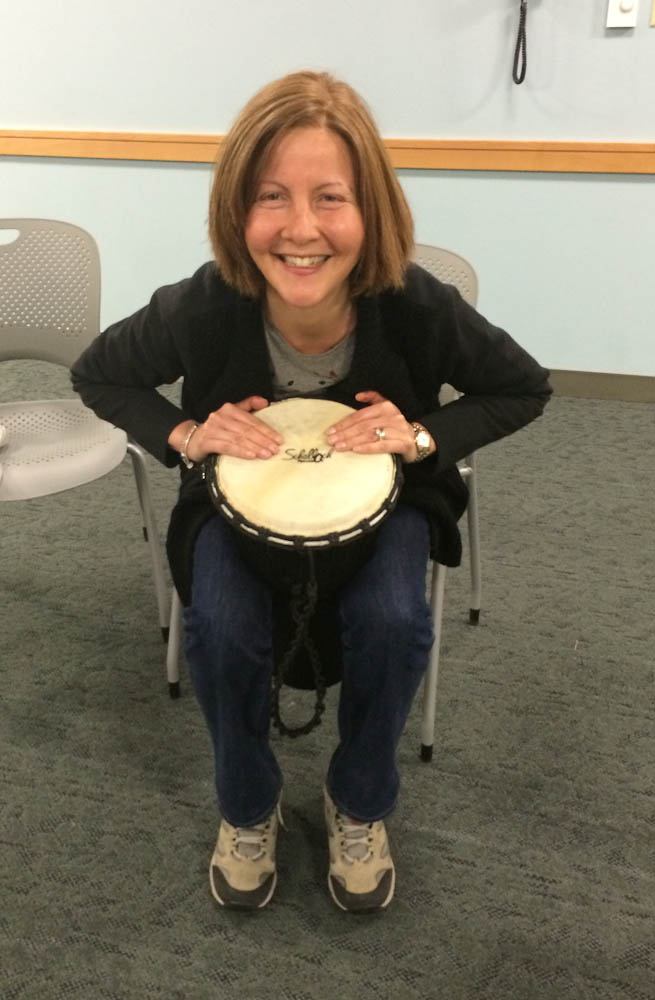 Zeynep drumming it out at one of her drum circle sessions.