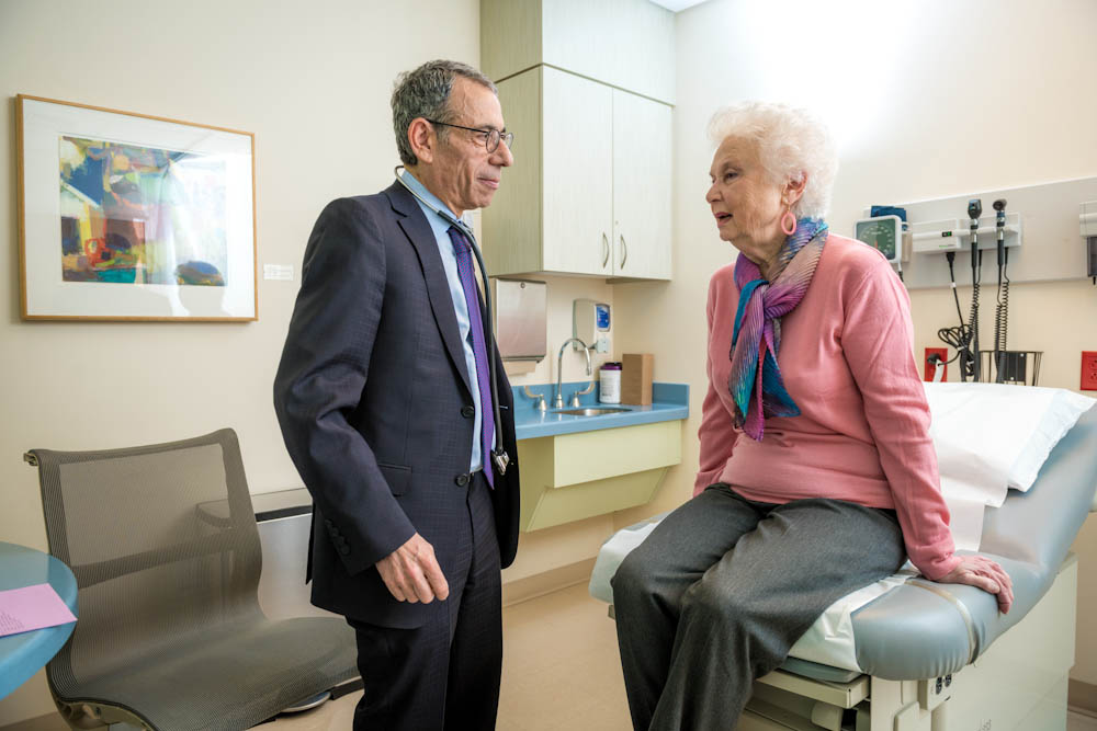 Eric Winer, MD, with a breast cancer patient.
