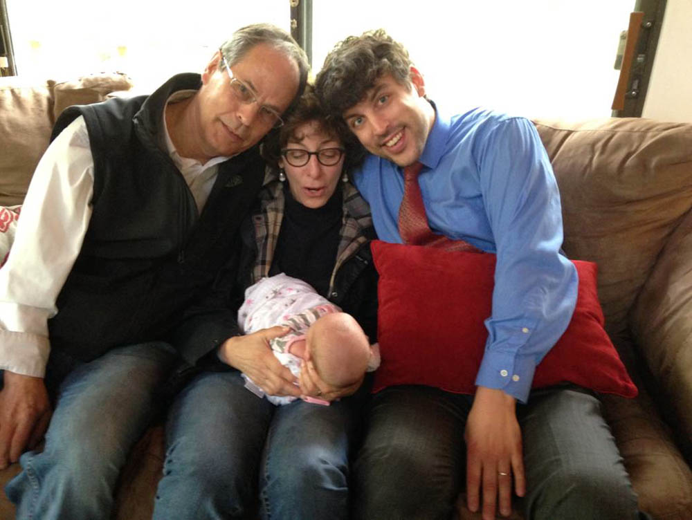 Faye (center) with her granddaughter, husband and son.