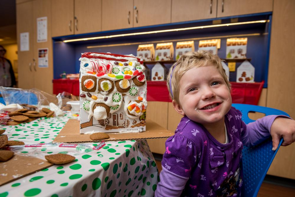 Young patients in Dana-Farber's Jimmy Fund Clinic kick off the holiday season by decorating gingerbread houses.