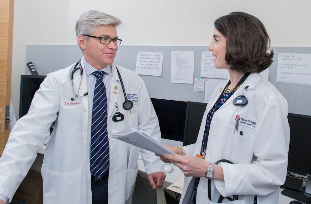 Erica Mayer, MD, MPH, a medical oncologist with the Susan F. Smith Center for Women's Cancers at Dana-Farber, meets with Dana-Farber Chief Medical Officer Craig Bunnell, MD, MPH.