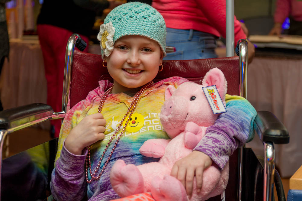 Patients enjoy festivities and plenty of plush piggies during the annual Jimmy Fund Clinic Pig Day.