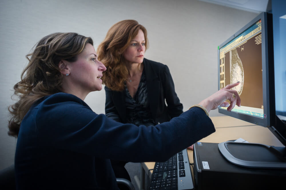 Dana-Farber breast cancer experts Ann Partridge, MD, MPH, and Tari King, MD, discuss results from a breast cancer scan.