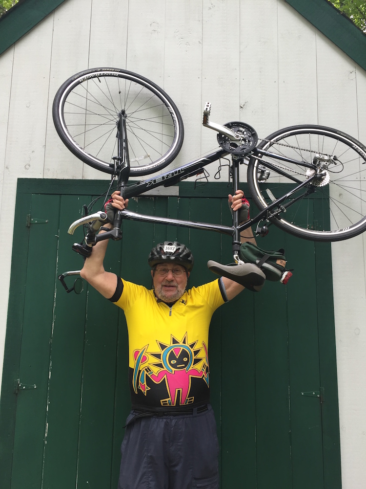 83-year-old Harry Beskind holds up the bike he'll ride for this year's Pan Mass Challenge.