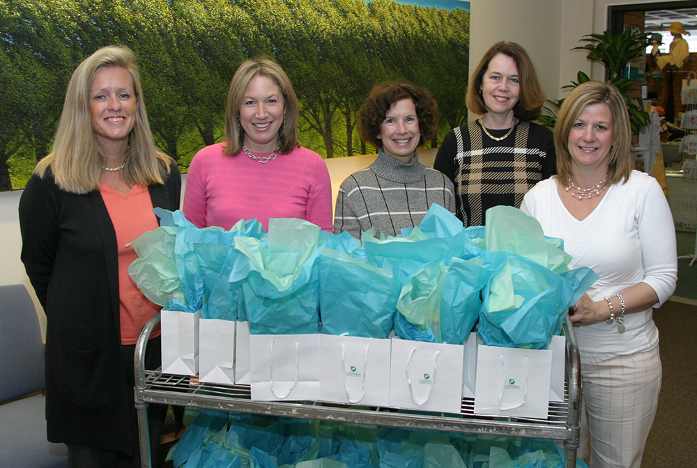 Lauren Frei (second from left) and members of Friends prepare to hand out gift bags to patients.