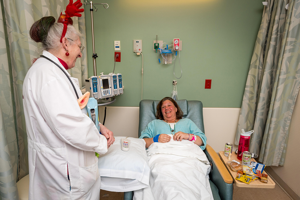 "As a member of the ""Humor Us Healers,"" Joan visits the bedside of patients like Jennifer Polk."