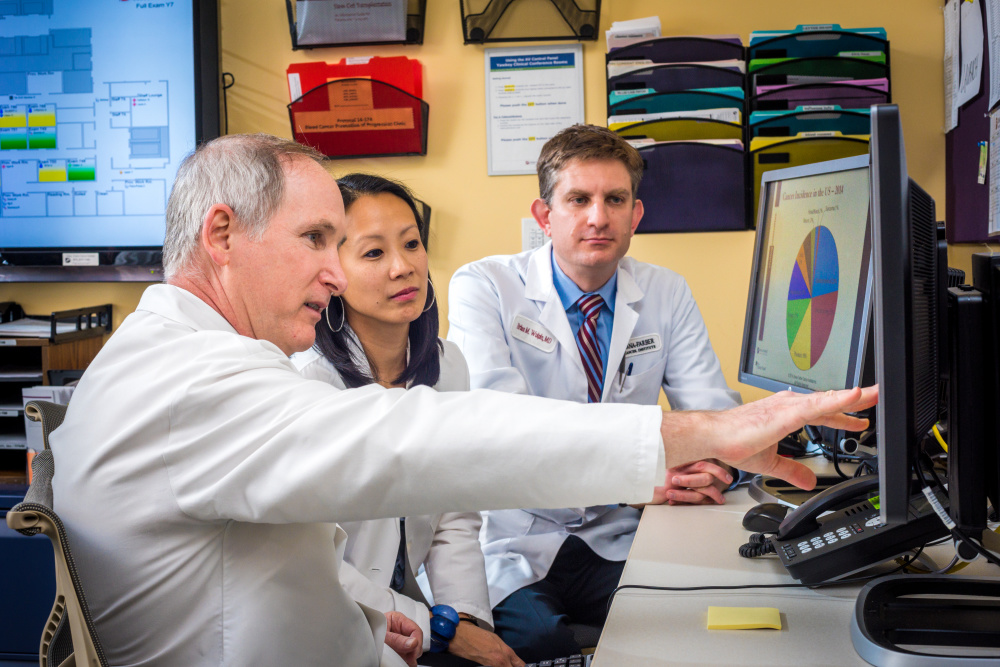 Charles Fuchs, M.D., Kimmie Ng, M.D. and Brian Wolpin, M.D. in the Yawkey 7 workroom. For story in Oncology Advances about the Pancreaticobiliary Center. Gastrointestinal Oncology.