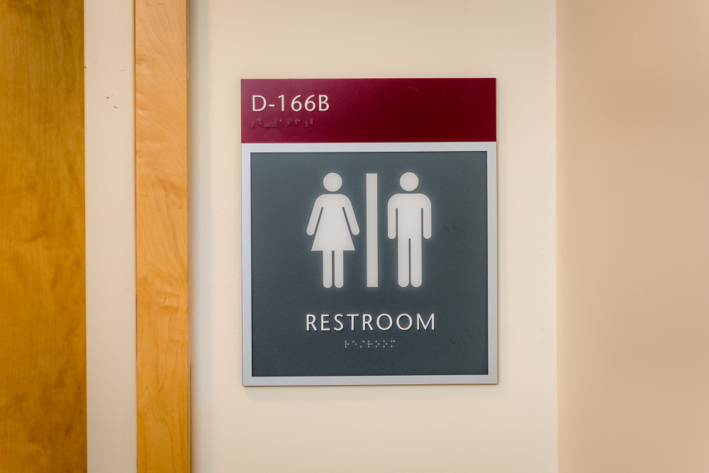 "Dana-Farber's LGBT & Friends Employee Resource Group (ERG) worked on several initiatives during 2016, including changing signage at all single-sex (one stall) restrooms on the Longwood campus to ""Unisex"" and developing a policy to support transgender staff transitioning at work. Sarah Winawer-Wetzel, chair of the LGBT & Friends ERG, received help on the initiatives from Beth Dean, Human Resources business partner."