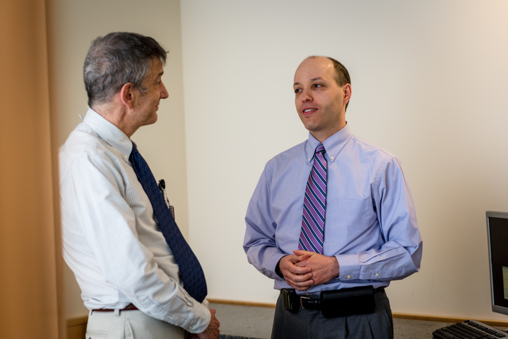 Douglas Brandoff, MD (right), provide support to patients at every stage of illness.