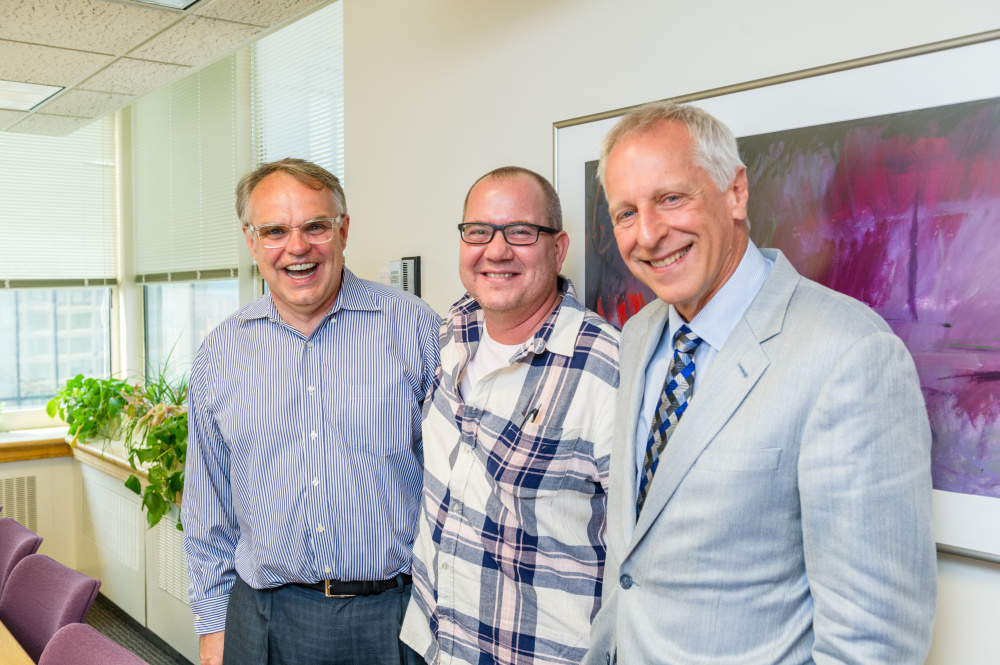 Patient Todd Ellison (middle) returned to Dana-Farber in September 2017 to celebrate the 20th anniversary of his bone marrow transplant.