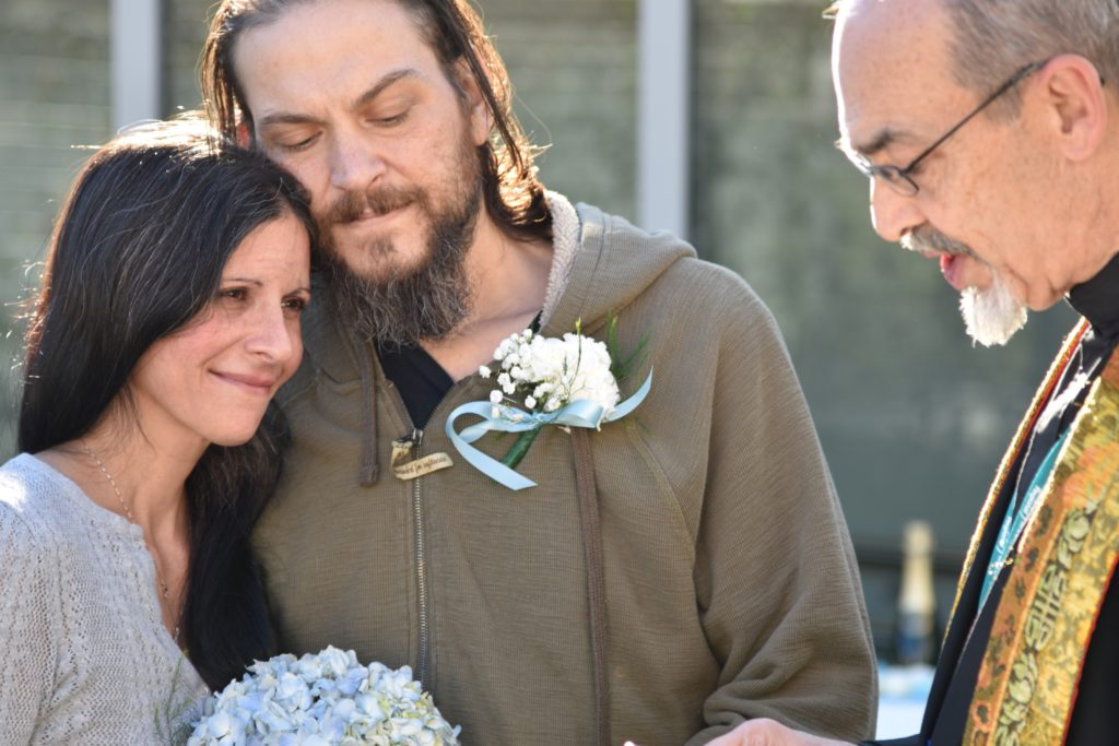 Dana-Farber patient Anthony Lewis Jr. and his wife, Jennifer Lewis, were married in the tranquility garden at Milford Regional Medical Center on Oct. 18, 2017 as their family and caregivers from Dana-Farber/Brigham and Women's Cancer Center at Milford Regional Medical Center looked on. Photo by Jennifer Shepherd