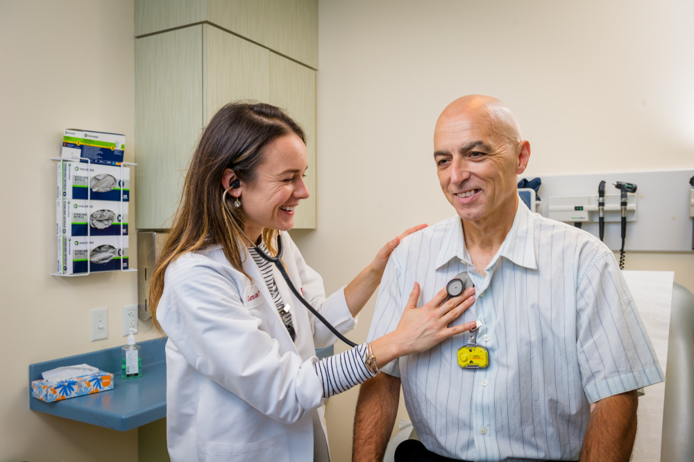 Dana-Farber's Lauren Gurschick, NP, with CAR T-cell therapy patient Honorio Figueira.