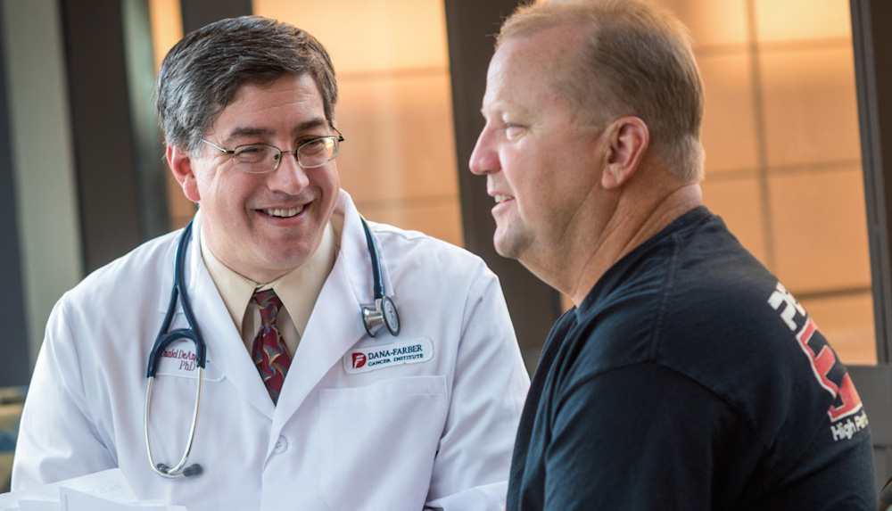 Daniel DeAngelo, MD, PhD, director of Clinical and Translational Research for the Adult Leukemia Program at Dana-Farber, consults with a patient.