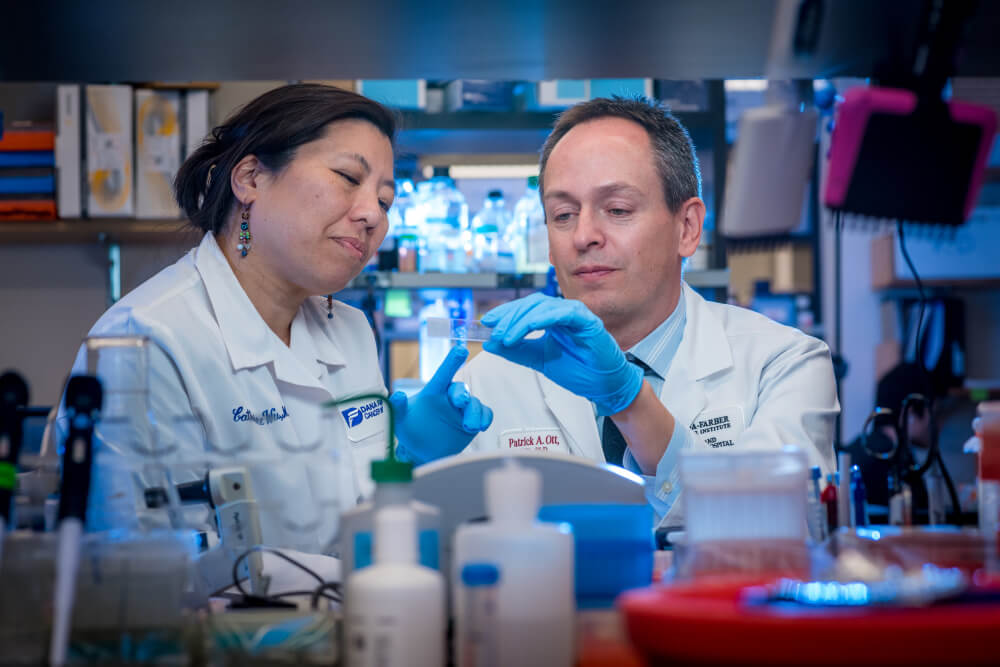"Catherine Wu, MD (right), and Patrick Ott, MD, PhD, are testing a vaccine, NeoVax, that is personalized for each patient and contains ""neoantigens"" that stimulate an immune response."