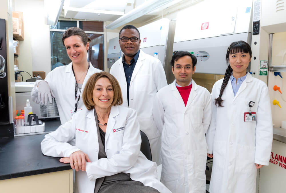 In addition to serving as president and CEO of Dana-Farber, Laurie H. Glimcher, MD (front), is a prominent immunologist. She heads a laboratory studying the molecular pathways that regulate the immune system, with potential applications for cancer immunotherapy.