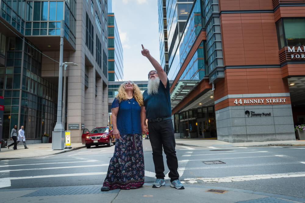Smith and his girlfriend, Beth Orliss, look at the updated Dana-Farber campus.
