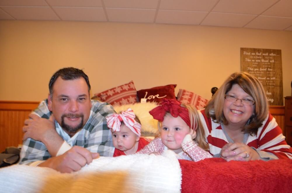 DeCosta and her husband, Eric, with their grand-daughters Henley and Aubree.