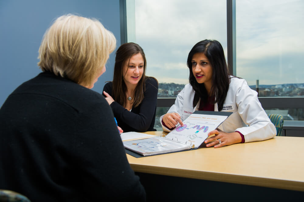 Huma Q. Rana, MD, clinical director for Dana-Farber's Center for Cancer Genetics and Prevention, talks to a patient.