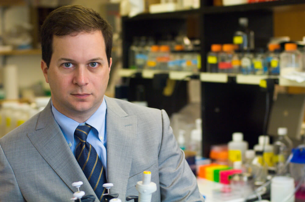 Andrew Wagner, MD, PhD, in his lab.