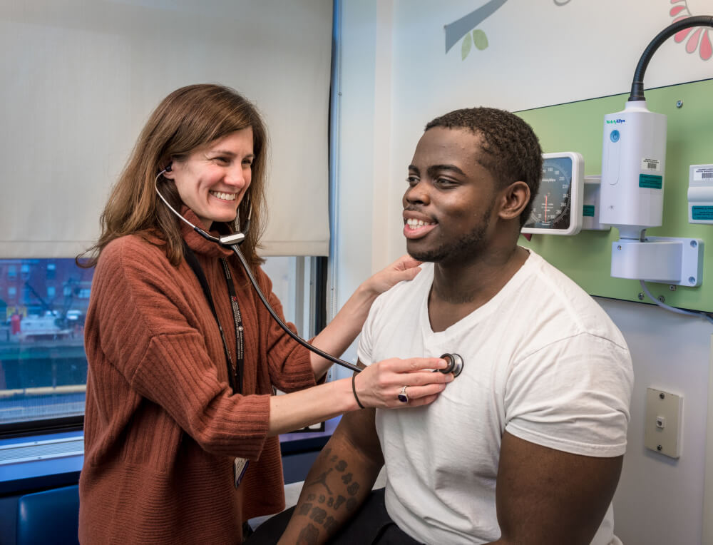 Erica Esrick, MD, and patient Manny Johnson.