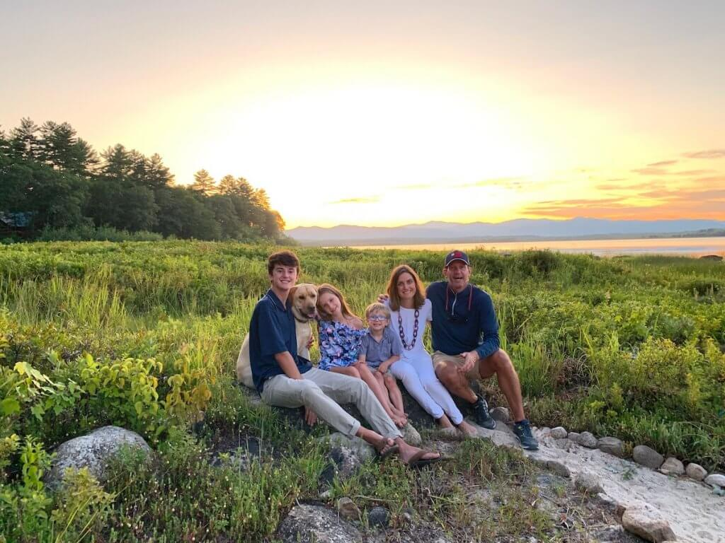 Owen, Lyla, Ryan, Kelly, and David Ives with their dog Moose on vacation in Maine, several years into Kelly's CLL remission.